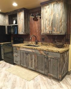 A little barnwood kitchen cabinets and corrugated steel backsplash. Love how rustic and homey it is! A little barnwood kitchen cabinets and corrugated steel backsplash. Love how rustic and homey it is! Pallet Furniture, Rustic Furniture, Furniture Ideas, Farmhouse Furniture, Luxury Furniture, Cabin Furniture, Western Furniture, Furniture Movers, Furniture Storage