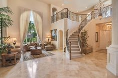 Luxury home interior with elegant living room staircase and balcony