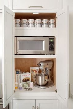 A MICROWAVE CABINET – While we admit that microwaves are an essential part of any kitchen, let's be honest: They're not pretty at all. This stately kitchen devotes an entire cabinet to keeping the appliance out of view. Plus, the counter space below it is ideal for prepping your leftovers before heating. Click through for the entire gallery and for more organizers.