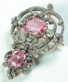 Brooch; Russian, Platinum & Gold Foliate Design, 2 Faceted Pink Topaz, 25 Diamonds, Diamond Accents.