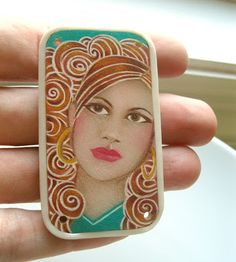 the wonder of colored pencil on Shrinky Dink plastic.