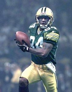 Andre Rison scores a touchdown for the Green Bay Packers during Super Bowl  XXXI Jan. 1997 in New Orleans. e21bf6ebf