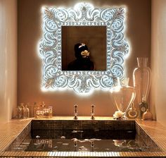 Sicis' mirror.  Glows in the dark due to rear lamp mounting. Love the 24kt and glass mosaic design.
