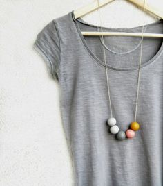 This colorful necklace composed of round handmade beads in: grey tones,pastel rose,ochre and beige cotton cord . The colors are created by hand and Handmade Beads, Handmade Necklaces, Handmade Jewelry, Wooden Bead Necklaces, Wooden Beads, Polymer Clay Necklace, Polymer Clay Beads, Undone Look, Diy Collier