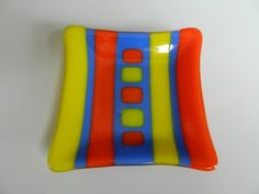 Fused glass plate in yellow blue & orange stripe by Glassquerade