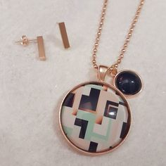 Working on a new piece for the 'Rose Gold Collection'....I'm a little obsessed with navy mint blush and rose gold at the moment! What do you think? I can't decide whether the navy small pendant is too heavy? Would a blush pendant be better? I welcome your feedback. It's sitting pretty here alongside the rose gold bar earrings available online now #lillybirddesigns #handmade #accessories #jewellery #rosegold #pendantnecklace #earrings #craftaustralia #girlbossesau #mumswithhustle…