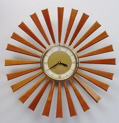 Midcentury Modern Starburst Clock, 24 Teak Rays, Atomic Wall Clock, Sunburst Design. $225.00