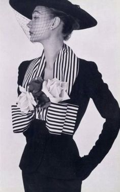 Sophie Malgat in a suit by Jacques Fath, 1952. How divine...