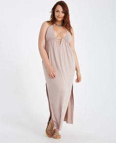 "<p>A must-have for summer, this maxi dress features a halter design, a super soft knit body, an open back, high side slits, and a cinched waist with a self-tie at the back.</p>  <p>Model wears a size small.</p>  <ul> <li>V-Neckline</li> <li>Sleeveless</li> <li>Pull-on Construction</li> <li>Bust Is Lined</li> <li>62"""" From Shoulder to Hem</li> <li>Rayon / Spandex</li> <li>Hand Wash</li> <li>Imported</li> </ul>"