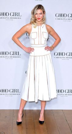 Looking good: Karlie Kloss put her modelling background to good use on Wednesday, as she posed up a storm at the London launch of Carolina Herrera's new perfume Good Girl on Thursday