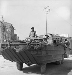 General Montgomery travels in a DUKW, 12 July 1943.  Operation Husky - The invasion of Sicily.