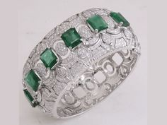 An 18-k white gold cuff that has been created using 20.01 carats of Gemfields emeralds;