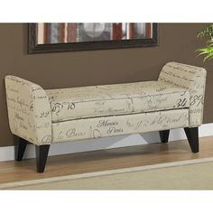 Add extra seating and a beautiful accent to your home with compact upholstered bench that tucks into tight spaces. A sturdy hardwood frame in rich espresso supports cotton-poly upholstery featuring French script in black and brown against a light tan.