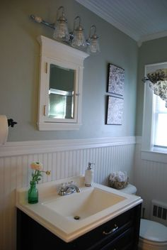 Image from http://homelinkbg.com/wp-content/uploads/2015/04/luxury-small-bathroom-remodel-presenting-beadboard-wainscoting-bathroom-in-white-accent-with-dark-bathroom-vanity-and-simple-single-sink-under-mirror-door-medicine-cabinet-also-lovely-wall-lamp-ideas-728x1087.jpg.
