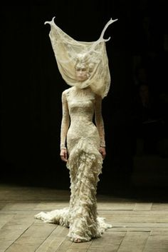 The new face of lace: an ethereal, Miss Havisham-style lace gown is paired with an antler headpiece, from autumn/winter 2006. The surreal juxtaposition is classic McQueen.
