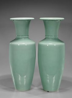 """Pair of Chinese celadon glazed porcelain vases; of conical from with tall waisted neck, thick ribbon at base of neck; H: 23"""" (each)"""