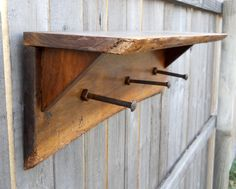 Rustic coat rack with bolts as hangers