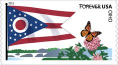 """The state flag of Ohio is a tapered, swallow-tailed shape, with 17 stars representing when the state joined the Union; the white circle with the red center is an """"O"""" for Ohio. Snapshot art for this 2011 stamp includes a butterfly, milkweed plants, and a stretch of river."""