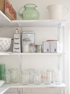 Design*Sponge Sneak Peek:  Kitchen shelf. Our kitchen is pretty small so last summer we decided to do a partial knock out into our dining room and also took out the cupboards and made these open shelves. It worked out better than we could have hoped: It invited in more space and light.
