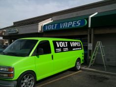 Millie (our Volt Vapes mascot Chevy Express van), parked out front of our Fairview location in Boise.