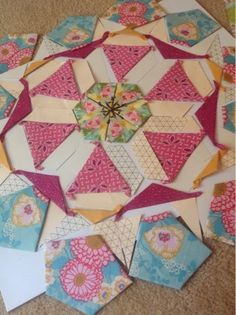 Periwinkle Quilting and Beyond: Millefiore moving along... (Great idea for using triangular graph paper, printed from the web!)