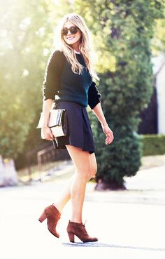 Update your basic miniskirt with a two-tone sweater, foldover clutch, and lace-up booties. // #StreetStyle