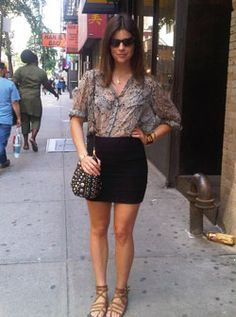 June 22. On this very hot day in NYC I am wearing an Equipment snakeskin printed shirt, with a Topshop mini skirt. The shoes and bag are Miu Miu and the sunglasses are by Tom Ford. As for jewellery, I am wearing a vintage Hermes Collier De Chien bracelet, a vintage silver bracelet I got in Croatia, a vintage scorpio pendant, my horoscope sign, and a Pamela Love Claw ring.