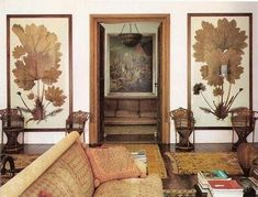 ORGANIC SUCH AS BOTANICAL- lovely eclectic living room with lots of wood and rusty rose colored accents. old rugs, large botanical art, old european feelings Interior Architecture, Interior And Exterior, Interior Design, Eclectic Living Room, Living Spaces, Living Rooms, Wall Spaces, Rhyme And Reason, Botanical Art