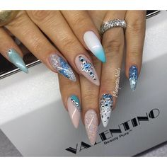 Blue nail art and bling stiletto nails