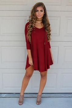 V-neck shift dress 3/4 sleeves Pretty burgundy color Rounded side dip hemline…