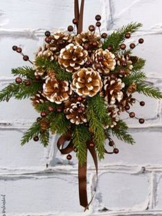 DIY Kissing Ball with Pine Cones - Crafts Unleashed Need an alternative to the traditional winter wreath? This beautiful pine cone DIY kissing ball is the perfect option - we'll show you how to make your own! Diy Christmas Decorations Easy, Pine Cone Decorations, Easy Christmas Crafts, Simple Christmas, Christmas Parties, Christmas Design, Holiday Decorating, Rustic Christmas, Outdoor Decorations