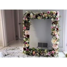 The giant floral frame I made for Emily and Dan's wedding this weekend. Used for the seating plan and then in the photo booth.