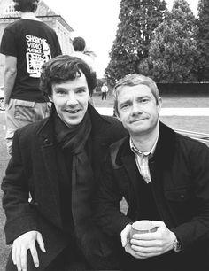 John enjoying some tea and Sherlock wondering where his cup is.