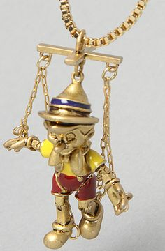 """Gold plated box chain necklace with functional enamel detailed marionette Pinocchi pendant; lobster clasp closure; 24"""" long with 4"""" extender.    By Disney Couture Jewelry"""