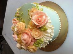 Light blue and pink buttercream flower cake