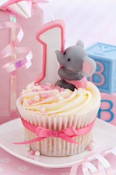 1st Birthday Ideas. Theme, venue, activities, and more. A cute first birthday party idea is a circus theme - love this sweet elephant cupcake!