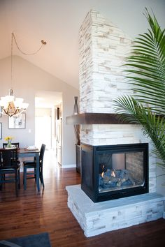 Three sided fireplace with faux brick chimney up to ceiling Basement Fireplace, Fireplace Update, Double Sided Fireplace, Brick Fireplace Makeover, Home Fireplace, Fireplace Remodel, Fireplace Design, Fireplace Ideas, Fireplaces