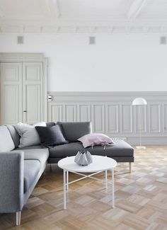 A simple grey and white sitting room in a magnificent Finnish apartment / Bo LKV & Marja Wickman.