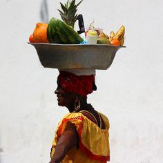 woman fruit vendor at Cartagena de Indias, Colombia by José Eduardo Silva