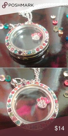 Floating Charm Living Memory Locket Comes with one charm and an assortment of floating crystals. Multi color crystals around face. Silver tone. Closes magnetically.  Has one hinge just to keep the front and back together and has wiggle but is suppose to be that way!. Strong magnetic closure. Locker is about the size of a quarter. Lobster clasp.  THIS IS THE BEST GIFT FOR THAT SPECIAL SOMEONE! Jewelry Necklaces