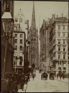 New York City sidewalk with horse drawn carriages and church in background. So neat to see this old pic, I saw this church when I was there.