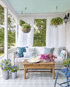 """Andrew Howard designed porch at """"The Prairie by Rachel Ashwell in Round Top, TX. Ceiling is Yarmouth Blue by Benjamin Moore"""