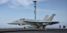 "A Boeing F/A-18E Super Hornet, from Strike Fighter Squadron 151 (VFA-151) ""Vigilantes,"" launching from the flight deck of the USS John C. Stennis (CVN 74)."