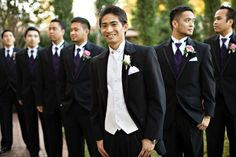 Attire for Groomsmen- i like the guys in the back with the dark purple vests