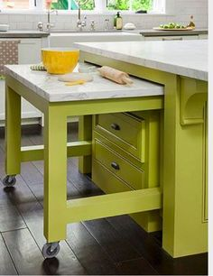 Add chopping space and extra seating to your kitchen with a hide-away nesting table. The caster-legged table rolls beneath the kitchen island when not in use.