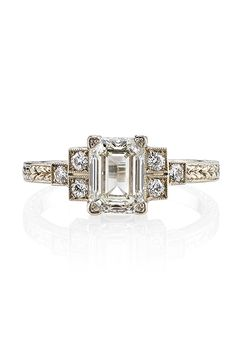 """Brides: Single Stone. 1.34ct emerald-cut diamond set in 18K white gold hand crafted """"Single Stone"""" mounting"""