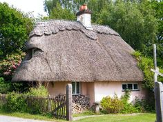 ~ pretty little pink thatched cottage