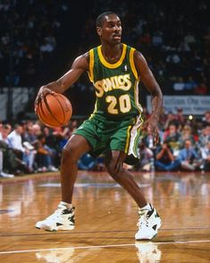 359289d9376 Gary Payton of the Seattle Supersonics dribbles the ball against the  Washington Bullets during an NBA basketball game circa 1993 at the US  Airways.