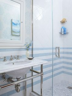 """Open Concept - great use of small space -- vanity opens up room- lightweight & extends to mirror - """"striped """" subway tile design adds dimension & character"""