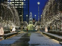 Constitution Plaza at Christmas, Hartford, Connecticut. Identified as an exemplary urban renewal project when it was completed in the roof garden in downtown Hartford was part of a six-building, three-block replacement of the Front Street neighborhood. New England States, New England Travel, Vacation Places, Places To Travel, Places To Visit, Great Places, Beautiful Places, Beautiful Boys, Christmas In America
